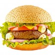 Big hamburger with beef cutlet and vegetables on white — Stock Photo #64364697