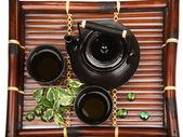 Green tea set on a bamboo mat — Stock Photo