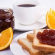 Breakfast with fresh coffee and toast with apple jam — Stock Photo #66982131