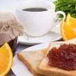 Breakfast with fresh coffee and toast with apple jam — Stock Photo #66982149