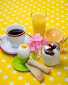 Breakfast including coffee, toast, eggs,  orange juice, muesli, yogurt,  fruits — Stock Photo