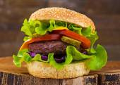 Big burger with beef cutlet and fresh vegetables — Stock Photo