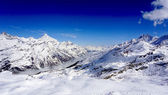 Snow mountains and blue sky — Stock Photo