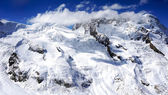 Snow mountains with clouds — Stock Photo
