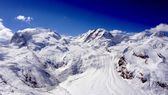 Snow alps mountains view and blue sky — Stock Photo