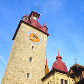 Clock tower in old town city Lucerne — Stock Photo