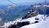 View of snow mountains titlis and cable car moving — Stock Photo