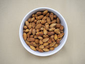 Almonds nut in a bowl on the canvas — Fotografia Stock