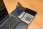 Calculator notebook laptop and phone on the table — Stock Photo