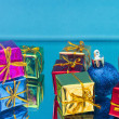 Christmas gifts and toys on a blue background — Stock Photo #74797771