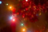 Bokeh garland on a Christmas tree — Stock Photo
