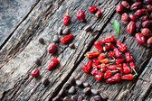 Square, heart, triangle of dried spices on wooden table unusual side view selective focus — Stock Photo