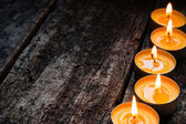 Flavored spa candle on a wooden background — Stock Photo