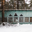 Wooden house in winter forest — Stock Photo #65722367
