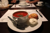 A plate with borsch — Stock Photo