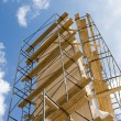Industrial construction: Isolated metal scaffold against blue sky — Stock Photo #71417043