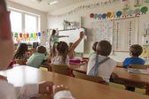 Lesson in primary school classroom — Stock Photo