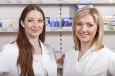 Two druggists in drugstore — Stock Photo