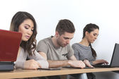 Students with laptops and tablets — Stock Photo