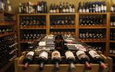 Wine bottles in a cellar — Stock Photo