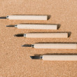 Set of chisels for wood on cork board background — Stock Photo #67461545