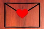 Empty envelope with heart on the table — Stock Photo