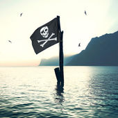 Pirate's flag wind in the sea — Stock Photo