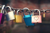 Series of colored padlocks with hart shape — Stock Photo