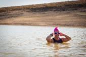 Female swimmer in a dam — Fotografia Stock