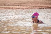 Female swimmer in a dam — Stock Photo