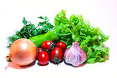 Vegetables and greens for salad on a white background — Stock Photo
