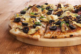 Tasty pizza with meat, olives and vegetables — Stock Photo