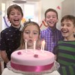 Cute little girl tries to blow out all the candles on her birthday cake in slow — Stock Video #66237149