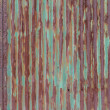 External rusty corrugated iron wall of a building — Stock Photo #64812005