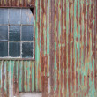External rusty corrugated iron wall of a building — Stock Photo #64812499