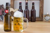 Refreshing glass tankard of frothy beer — Stock Photo