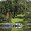Boat moored at river bank — Stock Photo #70929773
