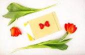 Red tulips with holiday card — Stock Photo