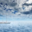 Sailing yacht on a peaceful ocean voyage to paradise — Stock Photo #64885135