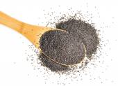 Spoonful of organic poppy seeds on a white background — Stock Photo