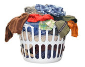 Pile of dirty laundry in a washing basket on a white background — Stock Photo