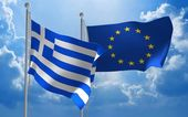Greece and European Union flags flying together for diplomatic talks — Stock Photo