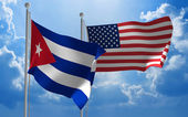 Cuba and United States flags flying together for diplomatic talks — Stock Photo