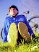 Man With Bicycle Resting On Grass — Stock fotografie