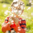 Child blowing dendalion,activity, aspirations, background, beautiful, blow, blowing, boy, bright, casual, cheerful, child, childhood, color, colorful, cute, dandelion, day, dreams, emotion, enjoyment, — Stock Photo #72443225