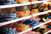 Shelves with sport shoes, sport store — Stock Photo