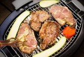 Grill, barbeque with pork meat and vegetables — Stock Photo