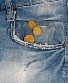 Old jeans with coins in pocket — Stockfoto
