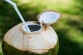 Coconut with straw — Stock Photo