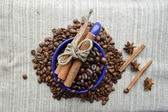 A hot Cup of coffee,coffee beans, Notepad, cinnamon, spices — Stock Photo